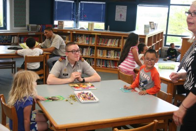 Librarian Tracy Gunn oversees a room full of smiles at William Perry Elementary